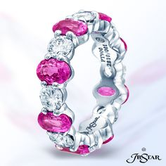Style 2810 Eternity wedding band featuring oval pink sapphires and round diamonds. Handcrafted in platinum