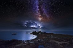 The Milky way with a storm rolling in over Corbiere Lighthouse, Jersey