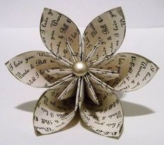Personalized Paper Origami Flower - I saw some of these made by Tahereh Mafi from pages of her books. So cool.