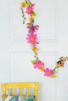Colorful paper flower garland can be hung horizontally or veritcal and used as as party or everyday decor.