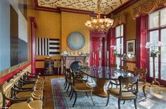 The large-scale dining room (pictured) has a ceiling with gold leaf tracery and complement...
