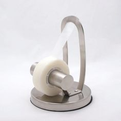 Almost scuptural in form, yet highly functional, this tape dispenser features a weighted base that allows tape to be dispensed with one hand, while it maintains a small footprint that maximizes desktop space.  The dispenser also employs a unique edge that cuts tape cleanly, but has no sharp edge to hurt fingers.  High quality stainless steel construction guarantees a lifetime of service.