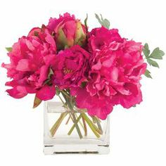 """Faux peony arrangement in a glass vase from Natural Decorations, Inc. Made in the USA.    Product: Faux floral arrangementConstruction Material: Polyester and glassColor: Fuchsia and green  Features: Includes faux peonies  Dimensions: 9"""" H x 11"""" W x 10"""" D"""