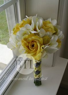 Just created, yellow rose and creamy white orchid, charcoal gray wedding bouquet by BloomedToLast on Etsy. www.etsy.com/shop/BloomedtoLast Yellow roses and billy balls are mixed with creamy white pulmeria and phalenopis orchids. Stems wrapped in charcoal gray ribbon and accented with a yellow ballet tie.