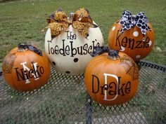 Family name and each family member on faux pumpkins so you can use them for years!
