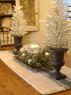 Great idea sparker!  Like the urns but shabby up, go another tree route, love the arrangement in between, cool for hall or buffet
