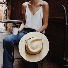 Double strap cross-cross v-neck tank with high waisted jeans and a straw fedora. A side raid or pinned curls rolled up away from your neck add cooler comfort on hot August & September days.