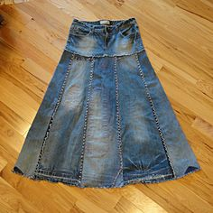 Made to order lightly distressed upcycled long jeans skirt that will develop more unique character as it ages. This long jean skirt has been designed to become more beautifully distressed with age. Worn/thin areas are backed with denim and enhanced with decorative stitching. With time
