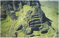 """'Easter Island - Land of Mystery' - photo courtesy of John Flenley;  """"Statues still lying at the top of Rano Raraku, where they were carved."""""""