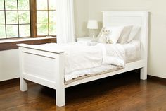 This DIY bed frame is attractive and well designed, using tongue and groove planks for a charming beadboard look. Just follow our step-by-step tutorial. #diy #bedframe