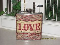 http://www.etsy.com/listing/92233609/love-decorated-6-oz-stainless-steel-hip