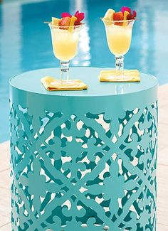 The Burano Laser Cut Side Table provides a pop of color between a pair of chaises or mixed with other outdoor furniture.  | Frontgate: Live Beautifully Outdoors