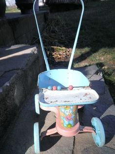 Vintage Tin Baby Doll Walker/Stroller Circa 1960 s by Pascalene, $55.00 My sister, Linda, had one like this.