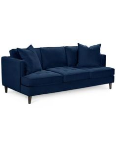 love this couch. macys has great cheap couches. navy + understated kilim rug = nice