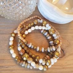 Natural stone bracelet set in shades of beige with gold metal beads by… Pearl Necklace, Beaded Necklace, Beaded Bracelets, Stone Bracelet, Bracelet Set, Shades Of Beige, Stackable Bracelets, Jewelry Design, Unique Jewelry