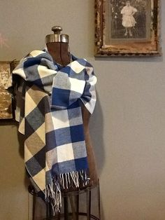 Stay warm and toasty with this gorgeous buffalo check scarf.  At Style Camp.