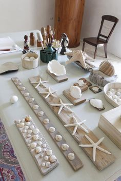 Beachy Wall Craft. Shells, sea glass...prefect for a nautical theme.
