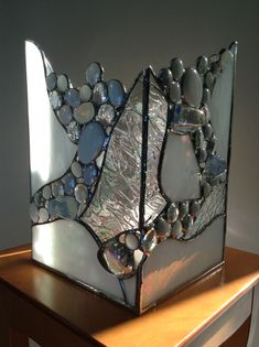 A large stained glass candle lantern (candle box) made from various types of glass such as clear iridescent and white glass. I have created and donated this item for my favourite children's cancer charity www.christopherssmile.org.uk for their silent auction to be held in October during their Ball at Wentworth.