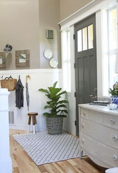 Benjamin Moore Kendall Charcoal for the door, Studio Taupe Behr All in one on the walls