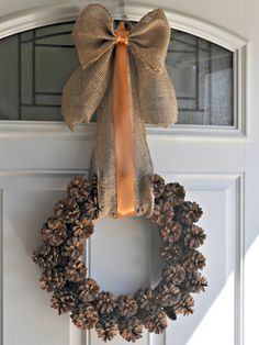 already have the pine cone wreath.. just need to add the autumnal burlap bow!