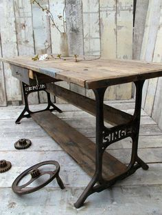 Use the metal parts from the sewing machine to make a table