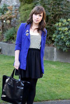 Blue blazer with striped shirt, black skirt, and black tights
