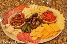 Meat and Cheese tray with pickles, olives, and sun-dried tomatoes. Serve with assorted crackers.