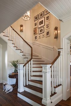 Beach Style Staircase by Norman Design Group, Inc. Photo arrangement on the wall