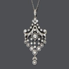A belle époque diamond pendant necklace, circa 1900 The floral surmount suspending knife-wire swags and terminating in articulated tassels, set throughout with single and old brilliant-cut diamonds, to a fine trace-link chain, diamonds approx. 1.80ct. total, lengths: pendant 5.5cm., chain 46.0cm.