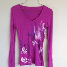 Purple long sleeve tee Lightweight long sleeve purple shirt. Has v neck and design on front. Very gently worn. Nollie Tops Tees - Long Sleeve