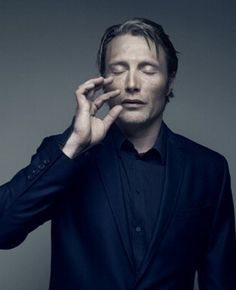 Mads with eyes closed.