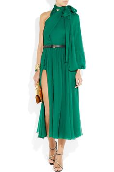 For FW11 Gucci pays homage to the glamour of the '70s, and this emerald silk-voile asymmetric dress is one of the key pieces from the collection. Maximize the jewel hue with metallic accents, showcasing the dramatic thigh split and matching briefs with your highest heels.  £2,291.67