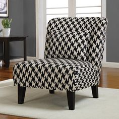 Add style and sophistication to your home decor with this lovely Anna accent chair. A black and white houndstooth pattern and black stained legs highlight this chair.