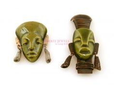 Feeling inspired by the Copan Ruins in Honduras.  Vintage Mexican Pre Columbian Masks Ceramic Brooches.    price: $175.00       Pair of Mexican mask brooches made out of high glazed ceramic. The larger brooch measures 3 1/2″ long and the smaller one is nearly 2″ long.