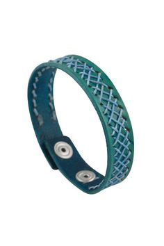 Only genuine leather has been used in the hand crafting of this product. The blue leather has been worked by an expert and is beautifully decorated with matching blue threads that have been woven together on the outside of the bracelet. This item is adjustable to ensure that it fits you.  Category page: https://bkkjewelry.com/en/10078-narrow-leather-bracelets