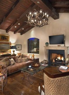 tv above fireplace in living room with vaulted ceilings.