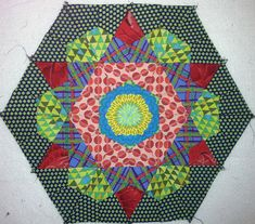 Pieced Hexagon using  Antique Rose template from Material Obsession... Its the same block as Jazz Hands by Sarah Fielke