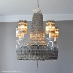 A DIY tutorial for a paper clip chandelier with 14,700 paperclips. I post this for those of you who have more time, patience, and paper clips than I do.