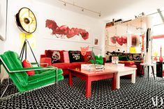 Check Out Demsey's Vibrant Home Photos | Architectural Digest A painting by James Nares hangs over a sofa by B&B Italia bedecked with pillows by Gucci; Alexander Calder sculpture