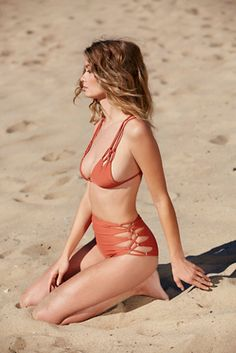 Queens Solid Bikini Bottoms  | Free people High waisted bikini bottoms featuring crisscross side ties with cutout detailing.