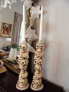 Dollar store skulls.  Stack, glue, add base, add holder (example used craft paint lid).  Paint as desired.