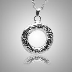 The Eternal Etched Keepsake Jewelry is 14k white gold and crafted by an artistic skilled jeweler one at a time. The quality is excellent and the craftsmanship is outstanding. This Keepsake Pendant holds a small amount of remains, a piece of hair or something that is small enough to memorialize your loved one and bring them close to your heart.