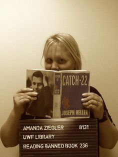 """Meet Librarian Amanda """"The Professional"""" Ziegler!   When she isn't leading the Professional Studies Library, she likes to partake in some Catch-22 by Joseph Heller. This book is yet another example of a book that has been challenged for it's content. See a map of which books have been challenged across the United States by visiting our libguide link below:  http://libguides.uwf.edu/BannedBooks #bannedbooksweek #uwf"""