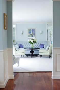 Formal living room designed by Christina Marie Interiors. Blue, green, purple