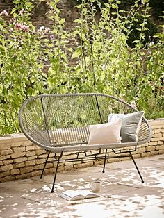 Inspired by our bestselling Grey String Chair, our string bench combines style and comfort to give a seating solution that is suitable for both inside and out. Woven from high quality durable plastic around a strong metal frame, it has a contemporary cocoon shape and high back.