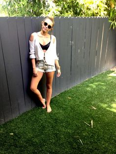 Miley Cyrus was wearing Citizen's of Humanity's cut off shorts in Natural Petite Rose