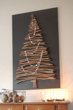 Looking for Christmas decoration for small space. Then you should definetly put up a wall Christmas Tree. Here are best DIY Wall Christmas tree ideas. Wooden Christmas Trees, Noel Christmas, Rustic Christmas, Stick Christmas Tree, Christmas Tree Canvas, Christmas Stairs, Pallet Christmas, Wooden Tree, Cheap Christmas