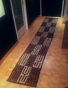 Handwoven runner made of raffia fiber. Ideal for contemporary interiors or modern spaces.   https://www.etsy.com/listing/198332300/mud-and-beige-runner