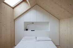 Great bedroom and closet Compact Karst House offers a contemporary twist on classic countryside living in Slovenia