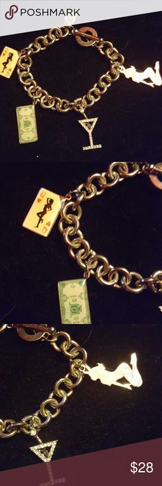 Playboy charm bracelet Officially licensed high roller Playboy charm bracelet with rhinestone martini glass, kneeling bunny silhouette, Playboy money, and cream colored queen of hearts card charms. I believe it's stainless steel but not positive. Never worn but no tags. Playboy Jewelry Bracelets